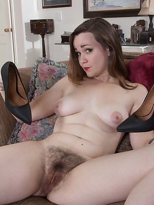 Kelly Morgan smiles and is wearing her new dress. Her dress and red lingerie come off and she has a very hairy pussy under those panties. She lays back with a smile again and shows us her hairy bush.