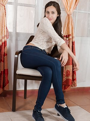 """Vilma sits on her chair, in her white blouse and denim pants. She innocently strips naked and shows off her slender 5'6"""" body. She gets on the chair, spreads open and gives her hairy pussy attention."""