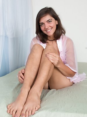 Katie Z lays in her pink lingerie on her bed alone. She has a very hairy body, with hairy legs, and a very hairy bush. She lays back, bends over, and shows us how beautiful her all-natural body is.