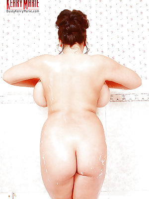 Chubby MILF pornstar Kerry Marie wetting down monster tits in shower
