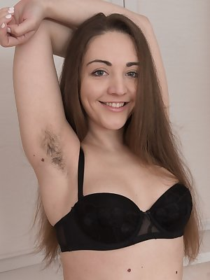 Amateur model Cherry Bloom doffs her black dress prior to showing her beaver