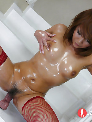 Japanese solo model Akiho Nishimura riding a dildo in fishnet stockings