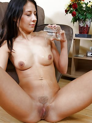 Dark haired solo girl toys pussy and anus after removing jeans and panties
