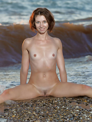 Slender sexy Oda show off her wet ass & tiny tits posing in waves at the beach