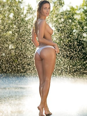 Solo model Cara Mell gets caught naked in a sprinkler during centerfold shoot