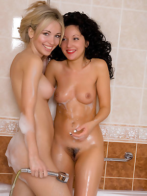Beautiful Natalia B and her best friend get naked and wet in the bath together