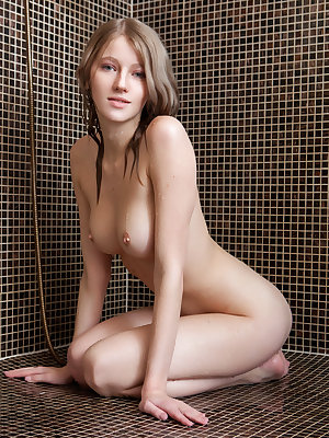 Blonde babe Mila I with bare feet showing tight ass & bald twat in the shower