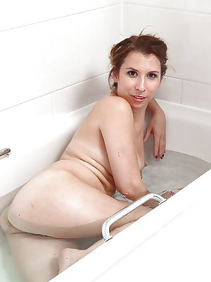 Mature lady Mariah stripping off lingerie in bathroom to expose hairy cunt