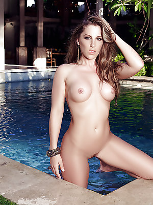 Hot centerfold model Sarah Louise playing with her big knockers