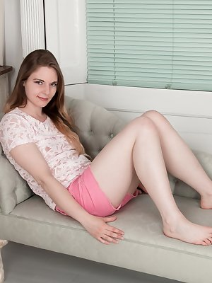 Alice Wonder lays on her sofa all dressed in pink. A sexy undressing leaves her 22 year-old body naked on the lonely sofa. There, her 34C natural breasts and hairy pussy get shown off.