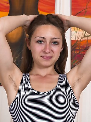 Morana is by her couch and shows off her hairy pits. Her grey top and stockings come off and we enjoy her hairy pussy. She is petite, playful, and erotic. Spreading her legs lets us savor her hairy bush.