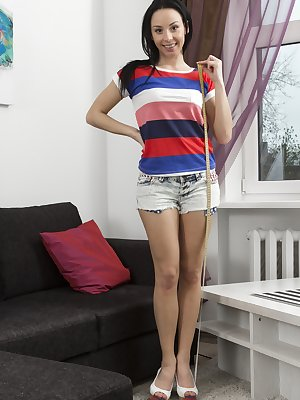 Anissa is wearing a colorful top and denim shorts while showing off her petite body. She measures her sexy figure, but when stripping naked shows off her 34B breasts and perfectly tailored hairy pussy.