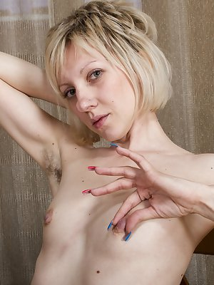 Sandy May is an alluring Russian blonde and her black dress and lingerie slide off her body. She has hairy pits, tats, and a hairy pussy worth taking a look at. She is slender, beautiful and exotic today.