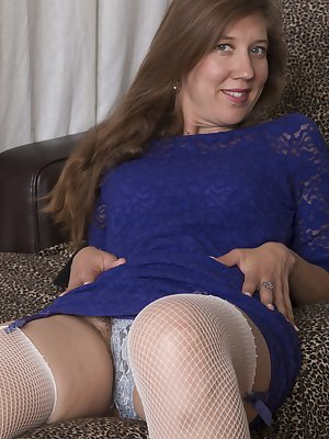 In a new dress and stockings, Valentine relaxes on her chair after a long day. She strips naked and shows us all how erotic she is, and how full her hairy pussy has become. She is a wonderful vision.