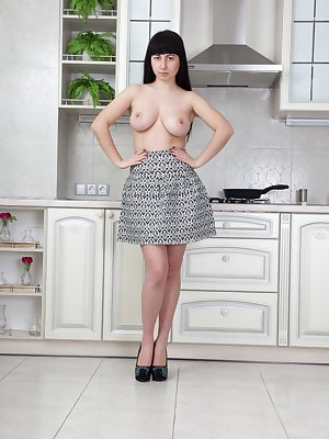 Tayra Jane loves her kitchen, and showing off her new grey dress. She flaunts her all-natural body, takes off her black lingerie, and is naked. She moves to her chair and shows us her hairy bush after.