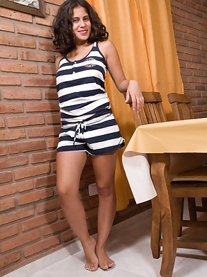 The petite and beautiful Latina Sally is on her kitchen, while in her striped dress. The dress and lingerie come off, and she shows her 36C breasts. But, her hairy pussy steals the show looking sexy.
