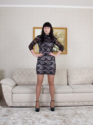 "Tayra Jane stands 5'8"", and is breathtaking in her dress, stockings, and heels. She undresses by her grey sofa and looks perfect with her 36D breasts. But, we keep on staring at her hairy pussy right?"