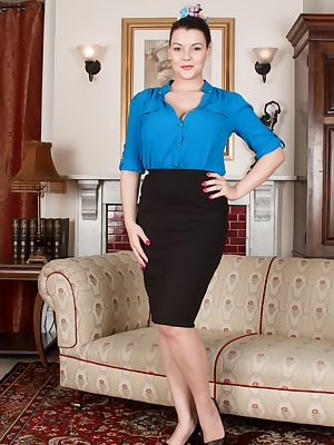 Cherry Blush is looking amazing again in her blue blouse and black skirt. Her blue matching lingerie comes off and her 32H breasts pop out. Those breasts mixed with her hairy pussy simply is hot.