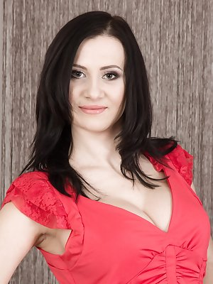Kaira poses in her red dress and black stockings. This hot Ukrainian is slender and hairy. She has 34D breasts and a full hairy pussy that she enjoys sharing with all. She is a perfect hairy gal.