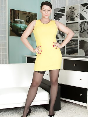 Cherry Blush has on her yellow dress with a black skirt and stockings. Under the dress, she shows off her hairy pussy and she sexy lingerie. Her 32H breasts are stunning, but her hairy bush is amazing too.