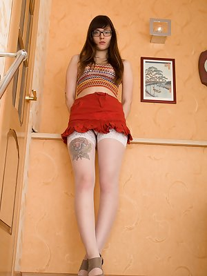 Anni Bay is a cute 18 year-old Russian all-natural with a red skirt and white stockings on. She lays back wearing glasses and strips naked. She shows off her hairy pussy and is extra sexy today.