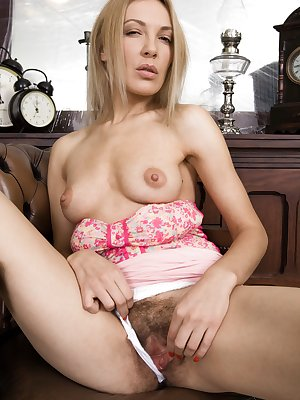Gina Monelli is a sexy Czech blonde in her pink top and pink blouse. She lifts her skirt and shows off her panties and hairy pussy. She then finds her pink vibrator and masturbates till orgasm.