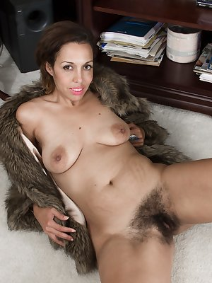 In her fur boat, Sophie Moore is sexy and exotic. Her black boots are amazing, but stripping naked shows off her 37 year-old all-natural body. There, we can enjoy her hairy pussy spread open to enjoy.