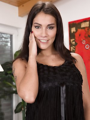 Elegant Mischel Lee is in her black dress and she takes it off to show her lingerie underneath. But, her glass dildo nearby is found. Laying naked on the sofa, she masturbates with the dildo to orgasm.