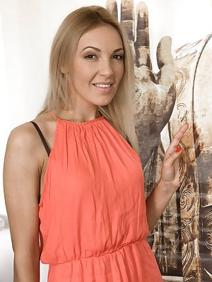 Gina Monelli is a sexy blonde Czech, who is sexy in her orange dress. She slowly takes off the dress and her lingerie and shows off a sexy all-natural body. Sexy poses and fun ensue afterwards.