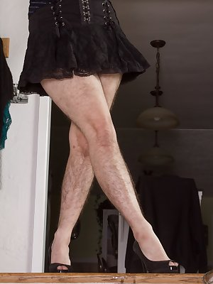 Harley stands at the top of her staircase, in a sexy black dress and shows off her blue panties. She takes off the dress and panties, showing her hairy legs and hairy pussy. See her have fun on the stairs.