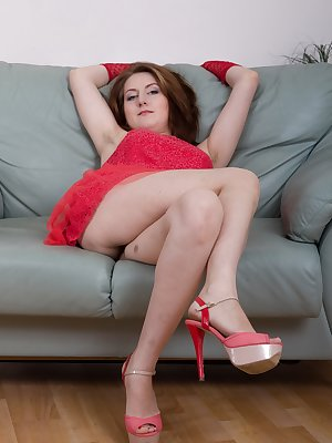 Sandy lays back in her sexy dress and heels on her chair. Her dress and lingerie come off her body and as it does, her hairy pussy is revealed. She lays back and rubs it until she is good and happy.
