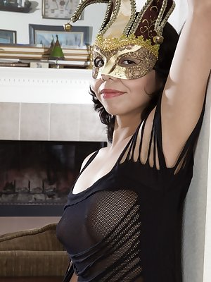 Maria Maldes is sexy in her black lingerie and gold mask. She slowly undresses and shows off her sexy 19 year-old all-natural figure and 32B breasts. Her hairy pussy though is beautiful on the floor.