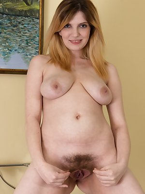 Terry loves to play music and look sexy. She plays the drums on her bed in blue and denim jeans. All done, she strips naked and opens her legs to show off her hairy pussy and very pink pussy lips to enjoy.