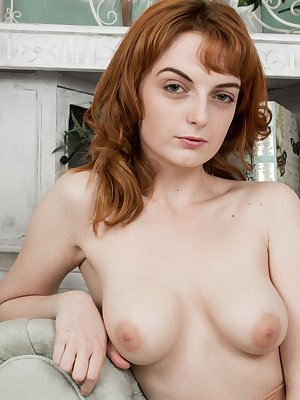 Lola Gatsby is a sexy UK redhead with a fiery all-natural body. She undresses and her pink lingerie flies off her 21 year-old figure. Underneath, her stockings cover her very hairy pussy for all.