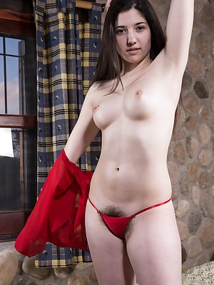 Virgin is young and sexy and in her red top. The clothes slide off, and her hairy pussy is full and rich to enjoy. Laying back, she spreads apart her pink pussy lips and shows off her sexy body in beauty.