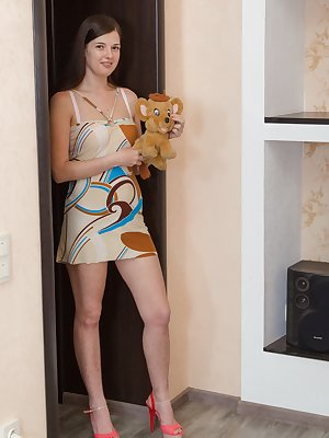 Lima enjoys her stuffed toys and loves being naked. The dress and lingerie come off, and Lima looks inviting. She lays back, spreads her legs and shows off her full hairy pussy, which looks so hot on her.
