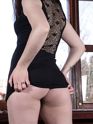 Virgin is by her window, looking alluring with her black dress. The dress, heels and lingerie slide off, and she shows off her all-natural body. She then fingers her pussy to show how moist she is.