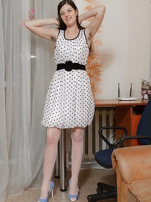 While showing off her body, Lima wears a polka-dot dress and shows her hairy pits. She slowly undresses and shows off her stockings covered legs. Soon, she finds her silver vibrator and masturbates with it.