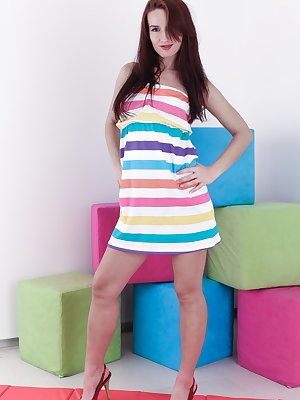 Promesita stands in her striped dress and heels and is a sight to behold. She lifts her dress and we see her very hairy pussy. She lays back on the blocks nearby, spreads her legs and puts on a sexy show.