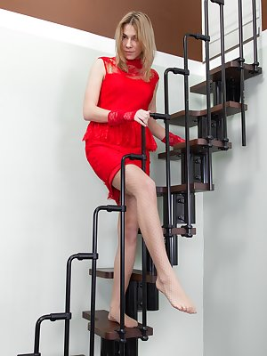 Alisia stands on the staircase in her lovely red dress and stockings. Her stockings cover her hairy pussy and we see her panties upskirt. All naked by the end, Alisia looks sexy and truly all-natural here