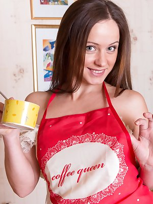 Wearing her apron with a denim skirt underneath, Shein is done cleaning and baking. Stripping on the table in her stockings, she gets naked on the table to spread her legs and show us her sexy hairy pussy.