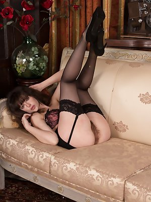 Looking elegant in her black dress and stockings, Kate Anne is stylish. She shows us her 32DD breasts halfway into the pictures and then spreads her legs to amaze us with her hairy pussy and wet pussy lips.