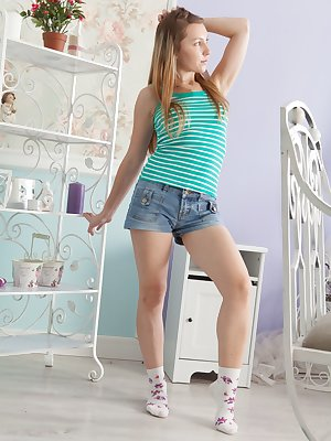 Stella is in her denim shorts showing off her sexy legs and looks hot. She strips naked, plays with her 36B tits and then gets naked. She spreads her legs and shows off her very hairy pussy and plays.