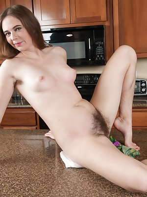 Camille is cleaning in her sexy green dress and wants to relax. She reveals her 34C breasts, then shows her hairy pussy in her purple panties. From then, it's all sexy all-natural beauty.