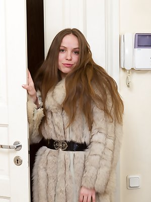 Gretta was just walking outside with this super hot coat. Little did anyone know that all she had on underneath was a sexy red outfit. Now that she's inside there's nothing but her lovely hairy body.