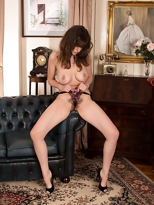 On her black sofa, Kate Anne looks beautiful. She shows off her long legs with a thong covering her hairy pussy underneath. Out her of her lingerie, she fingers her pink pussy lips and give us sexy pics.