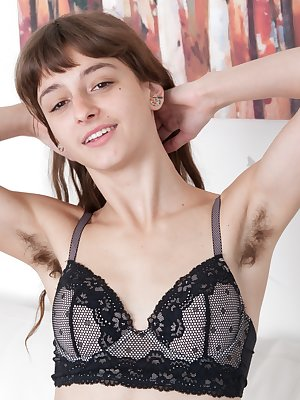Sexy young Willow is in her red top and loves to show off her hairy pits. She gets all naked and this petite American looks perfect with her all-natural body and hairy pussy. She shows off her body well.
