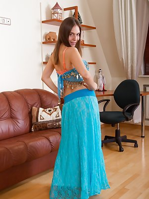 Agneta is in her beautiful blue belly dress and looks very exotic and erotic. She strips out of her dress and stockings, and combs through her hairy pussy. She is beautiful squeezing her 38C breasts and body.