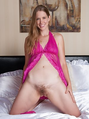 April is a sexy Oregon native, and she is sexy in her purple lingerie. She shows off her hairy pussy as she strips in bed. She plays with her nipples, shows off her ass, and fingers her hairy beaver.