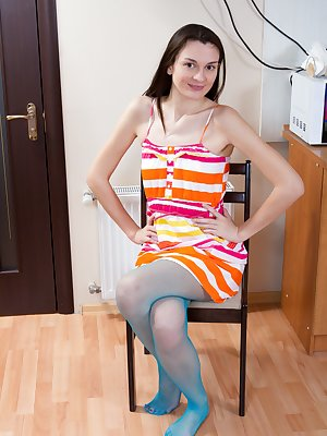 Eliza loves wearing her stripped dress and stockings. She sits in front of her lover and begins to pose. As her lover gets turned on, she strips and shows her hairy pussy to her lover.